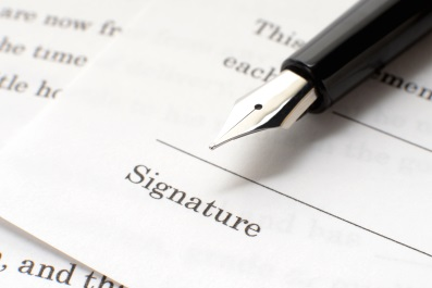 Signature with pen (photo)